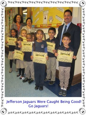MRs. Torterella with Mr. Celebrano and a fourth group of awards winners