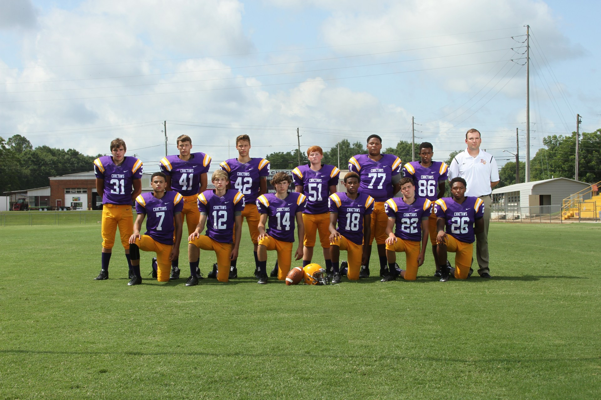 Bibb County High School Football players in purple and gold uniform