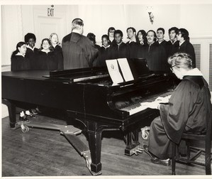 Ms Thode at the piano rehearsing the choir