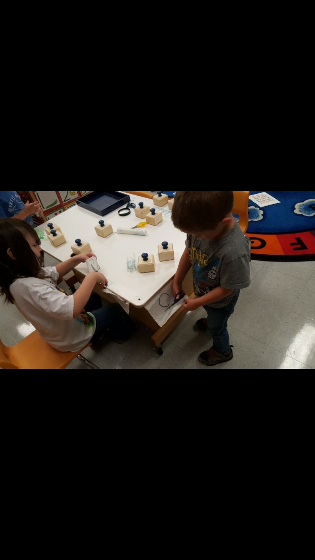 Cutting Shapes out of contact paper.