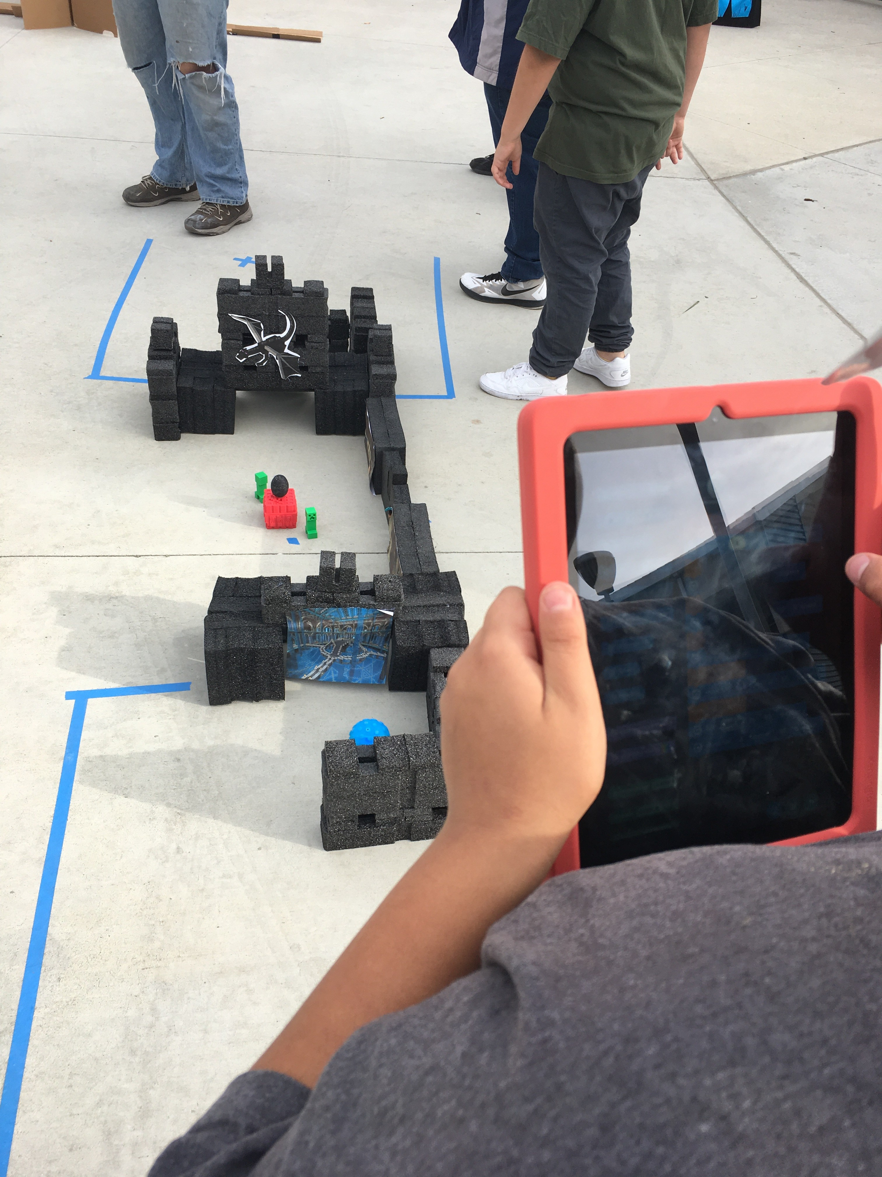 Students working with Robots at Hour of Code Activity
