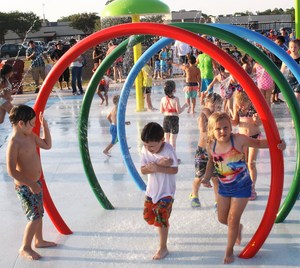 kids playing in splash pad