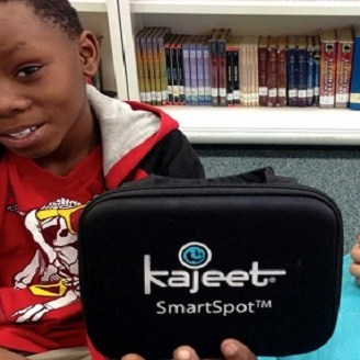 Kid holding a SmartSpot case