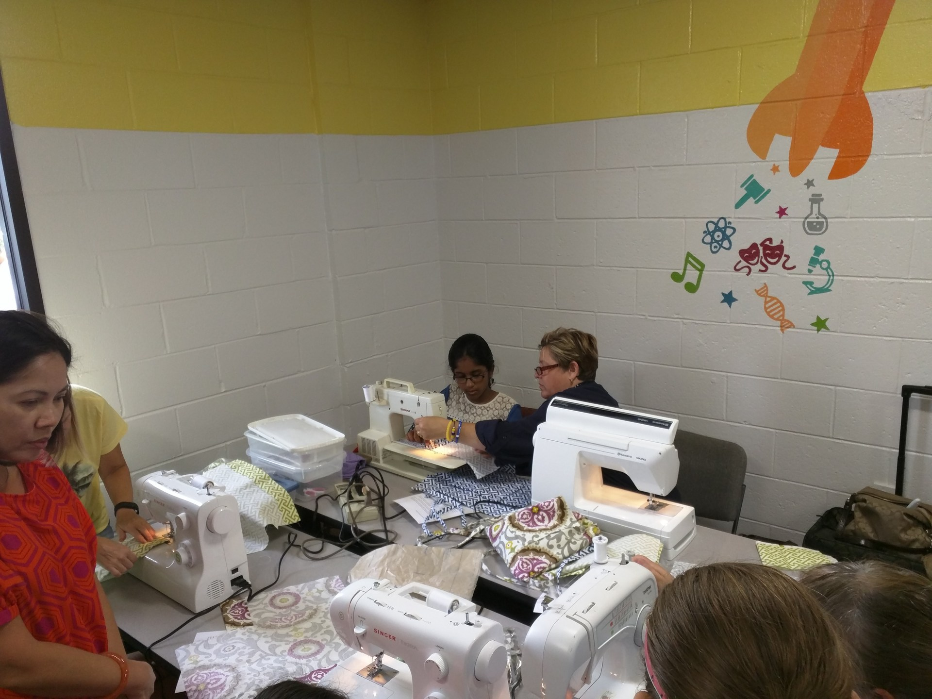 Learning to sew at Steam Camp.