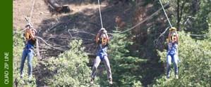 Student zip lines across ravine