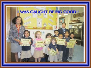 Mrs. Tortorella and Mr. Celebrano with students receiving their awards