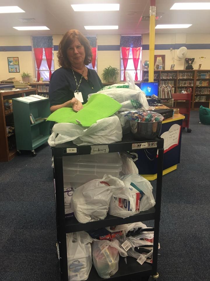 Mrs. Donofrio poses with the cooking club supplies.