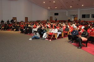 MHS students and football players watching ceremony.
