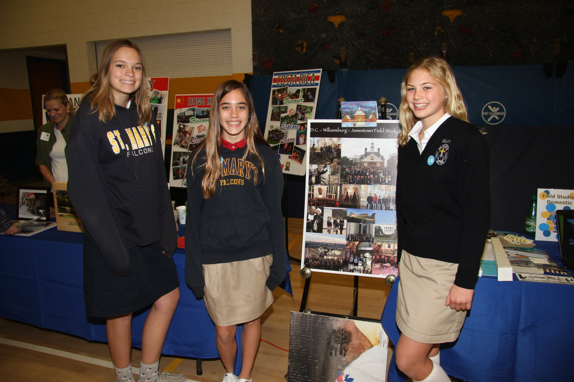 3 Middle School girls at admission faire