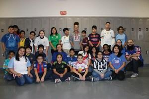 6th grade class showing off their jerseys