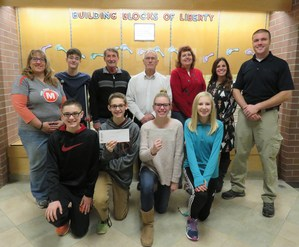 TKMS students present donations to the Veterans Memorial project in Middleville and to the Veterans Affairs of Barry County.