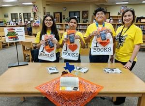 Pictured are AMJH winning team members Guillermo Hernandez (8th grade), Juan Perez (7th grade) and Alyssa Rivera (8th grade) along with Lilia G. Barrera (AMJH Librarian).