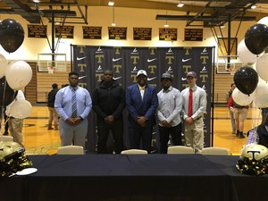 Five players sign to play college football.