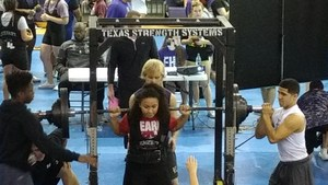 Jayla Quichocho squatting weights.