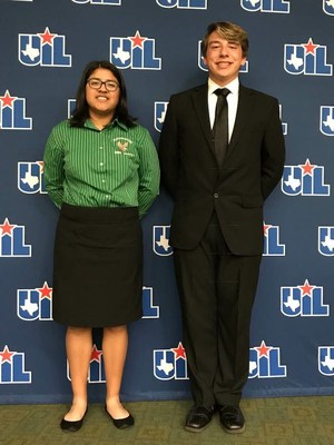 girl and boy standing in front of UIL drop