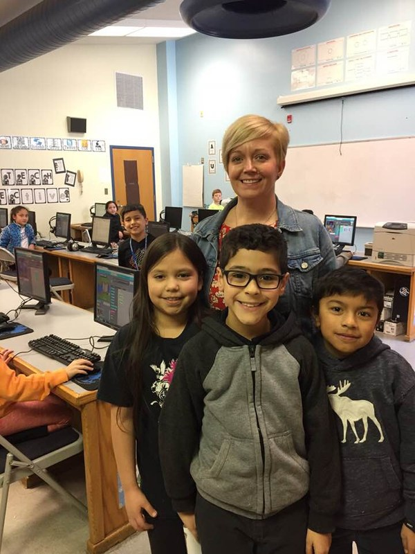 Mrs.Buchanan and some of her third graders during Technology class.