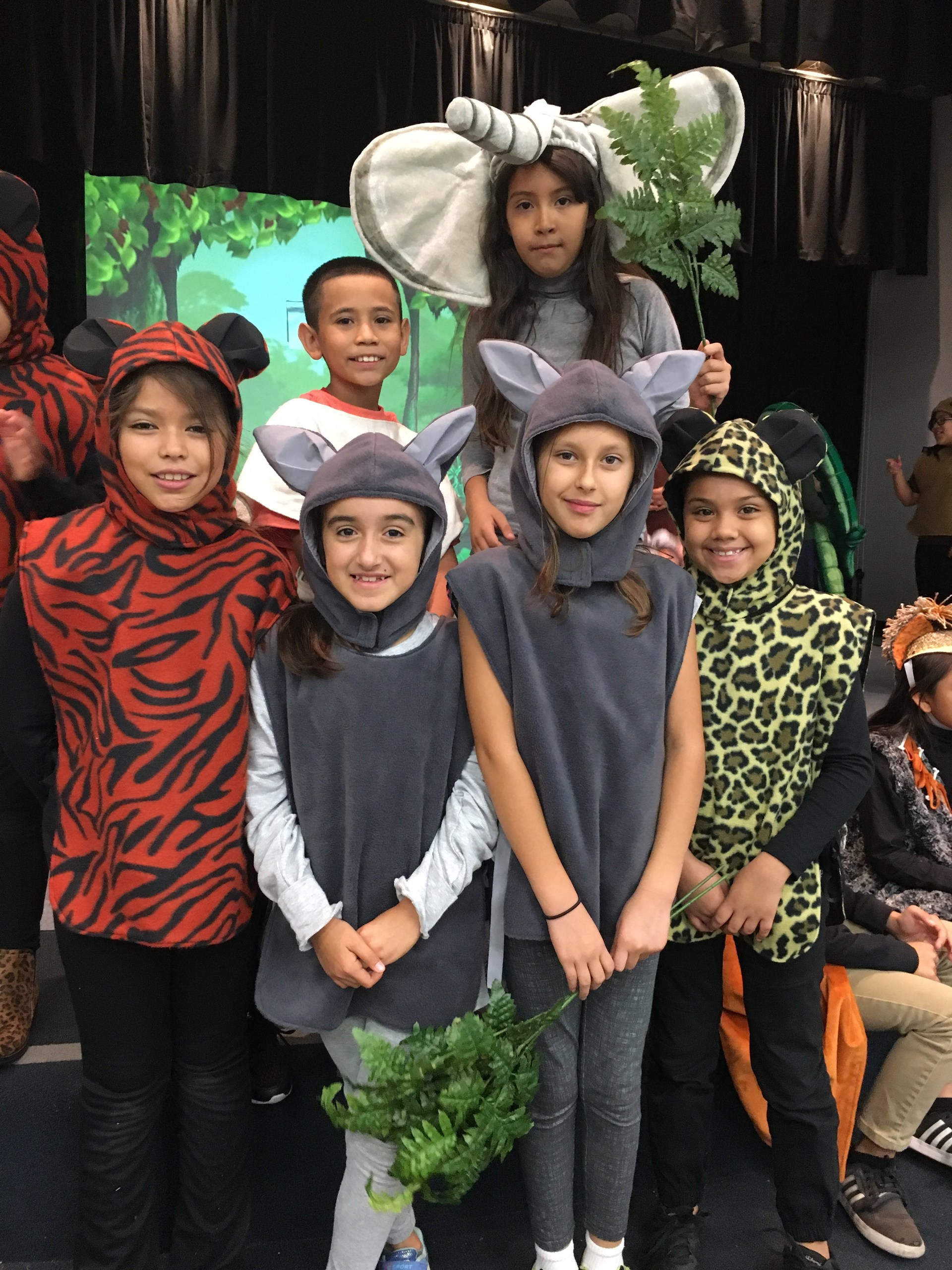 Students in animal costume in the show Jungle Book.