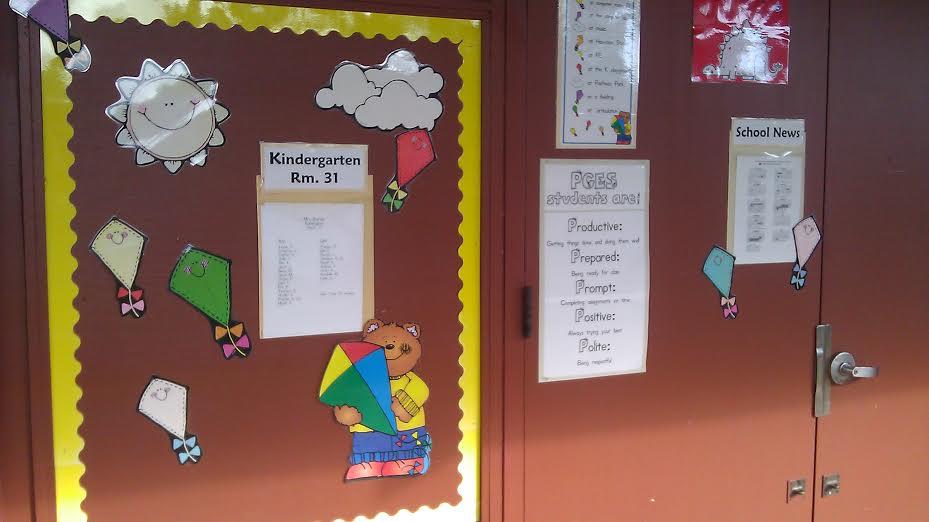 Mrs.Bourcier's Front Door Decorated with notices to read