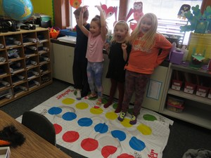 Some students had fun playing Twister.