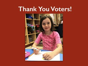 Thank you voters-young girl student at Jacob's Well Elementary School drawing at a table
