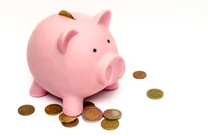 Image of a piggy bank and pennies.