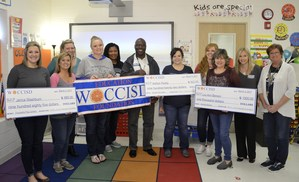 Teachers display grant checks!