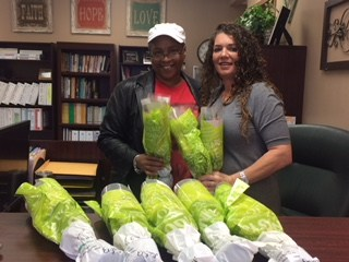 Vicky Whitley with Fatima Court #30 Shriners delivers flowers to Tipton County Teachers.