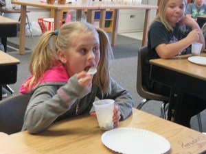 A Lee Elementary student enjoys an ice cream float made with Michigan-made Hudsonville ice cream and Vernor's Ginger Ale.