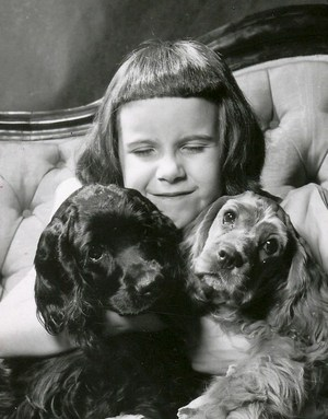 Sweet young girl holding 2 small dogs