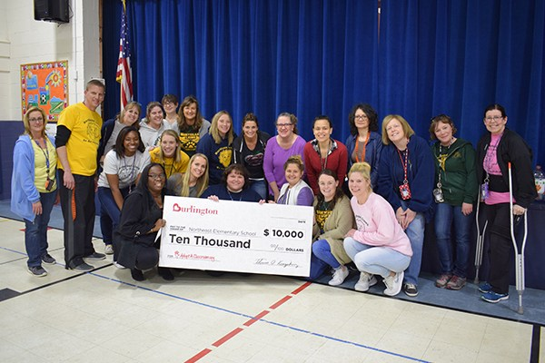 Northeast teachers with check.