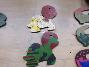 The students made alligator, turtle and pig puzzles.