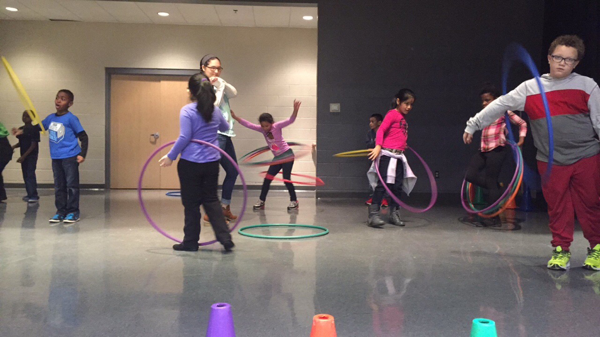 students hula-hooping