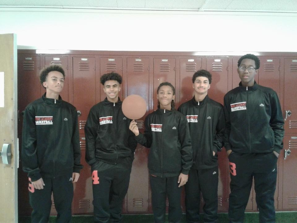 The boys basketball team present their new team jumpsuits.