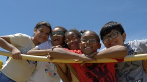 Group of sweet students playing on the playground, They attend West View Elementary School.