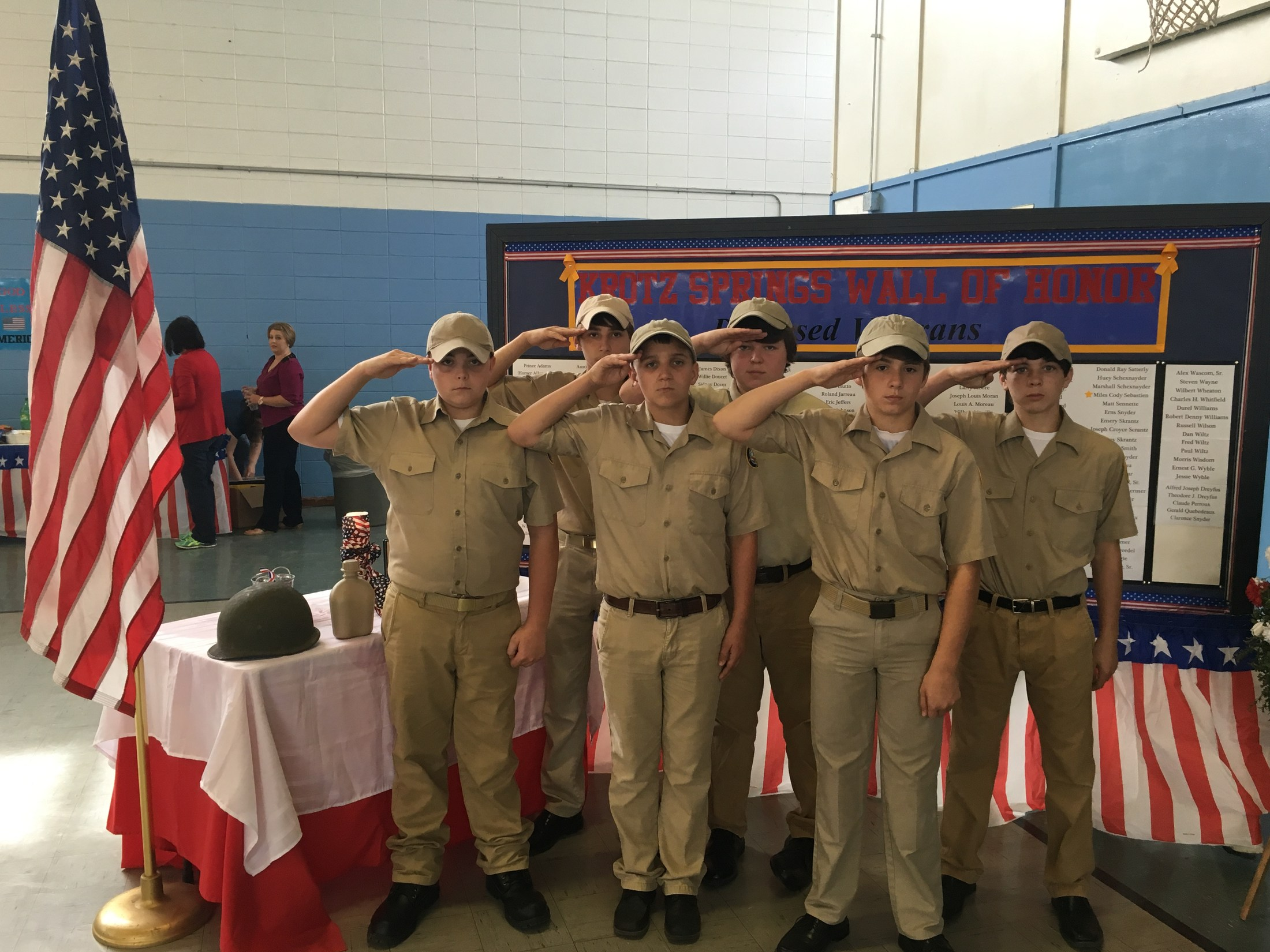 Group pic of saluting Jr. ROTC cadets