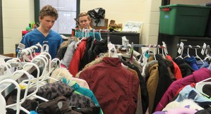 Mitchell Corner, right, helps Wyatt Miller find just the right jacket for a student in need.