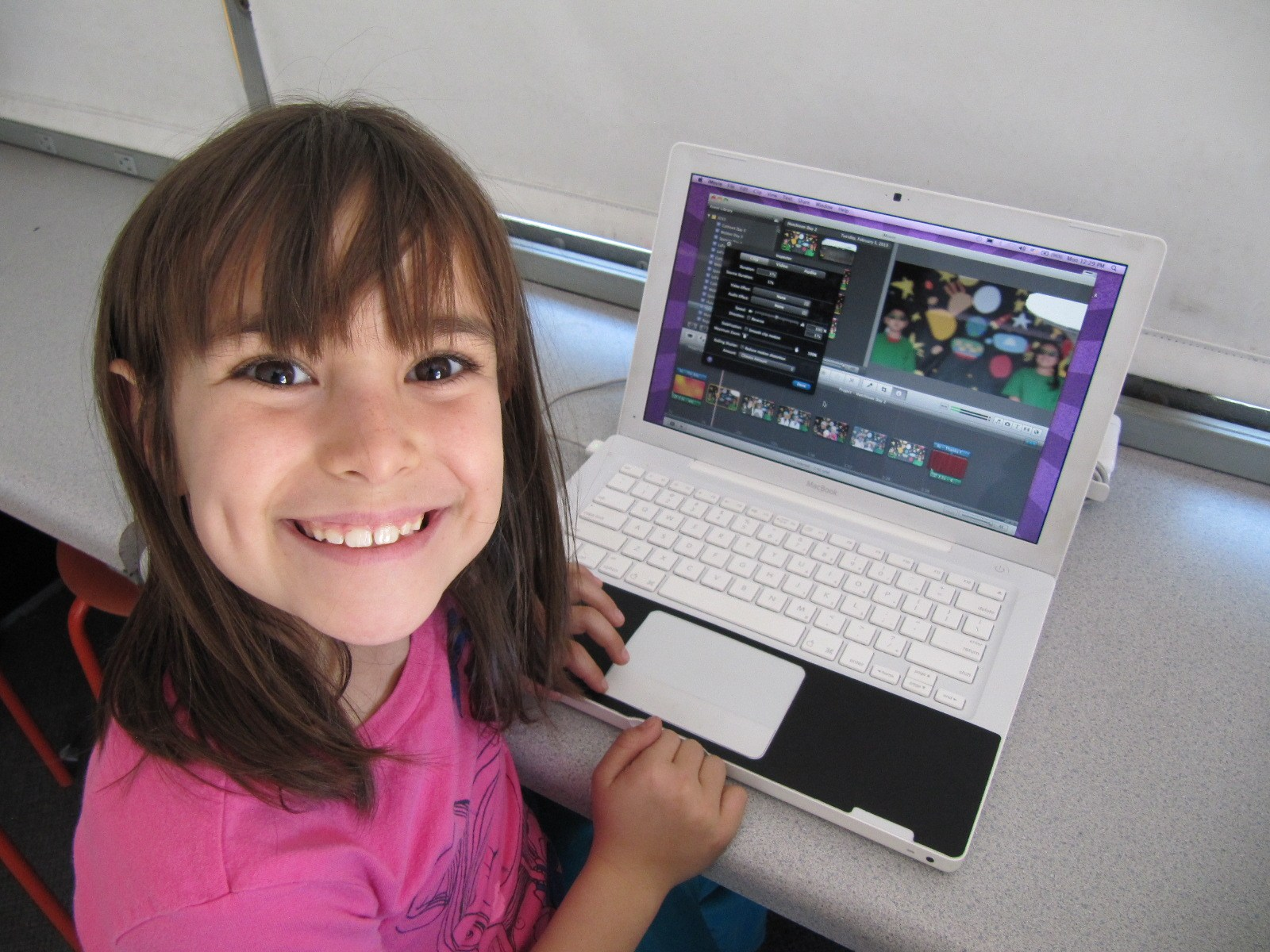 A gril editing her film on a computer.