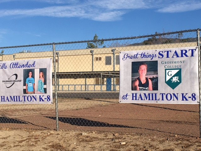 Two Hamilton graduate banners showing where they are attending college.