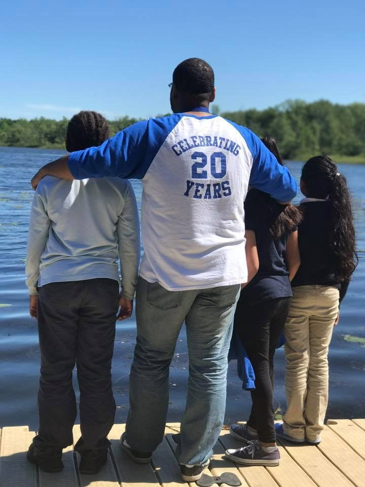 Mr. Smith and students enjoying a field trip to a lake.
