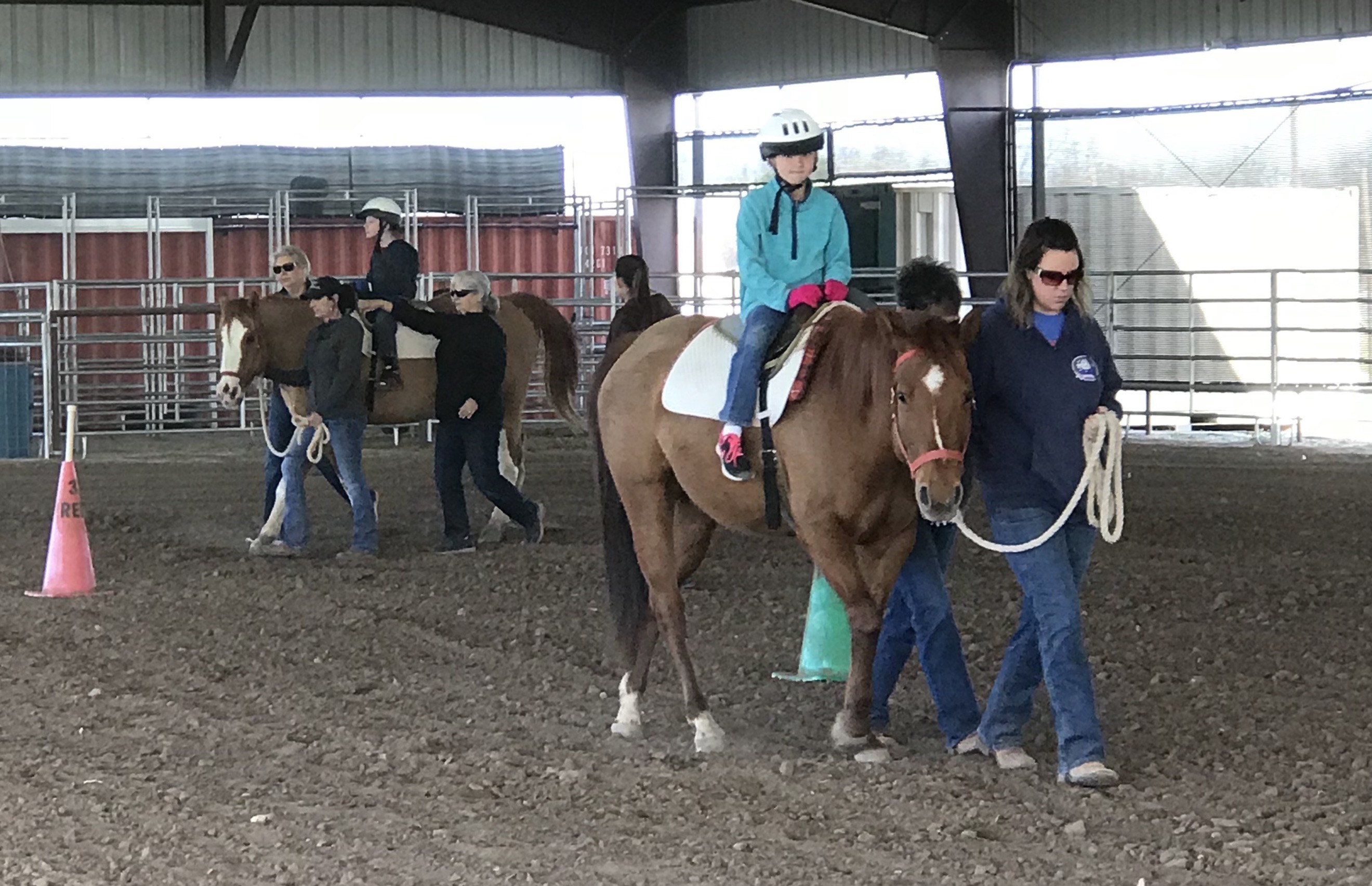 Students ride horses at Sonrisas.
