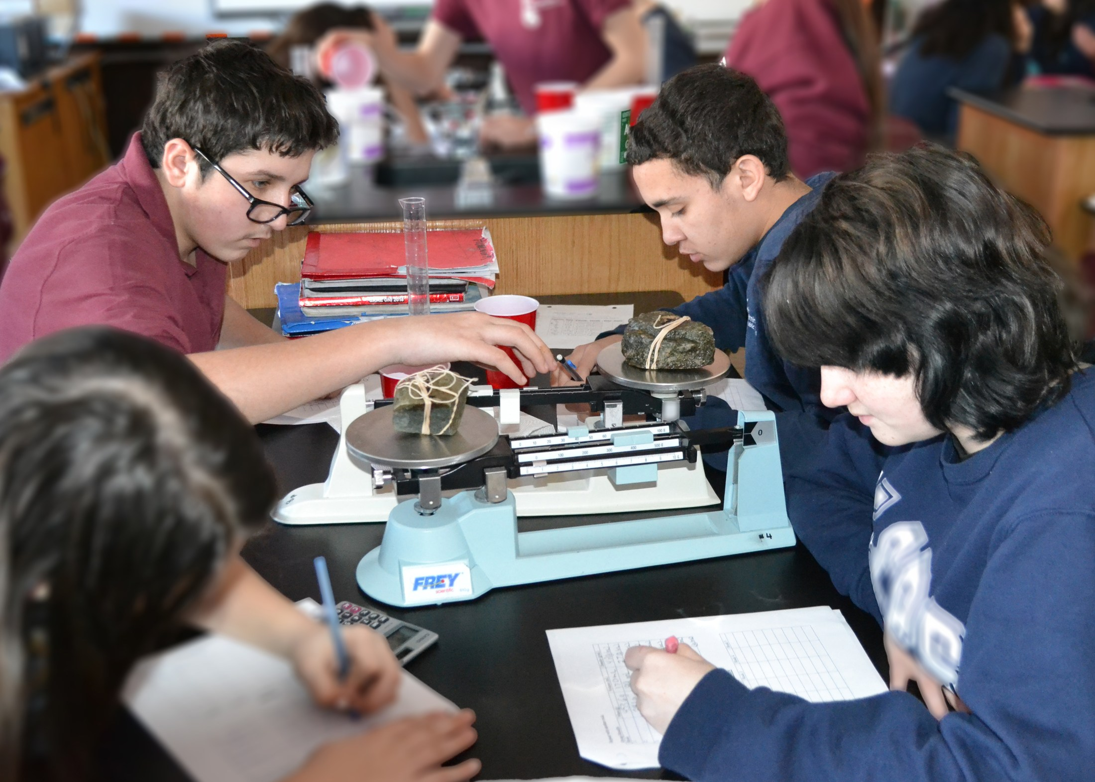 MIddle school students conduct experiments in the science lab.