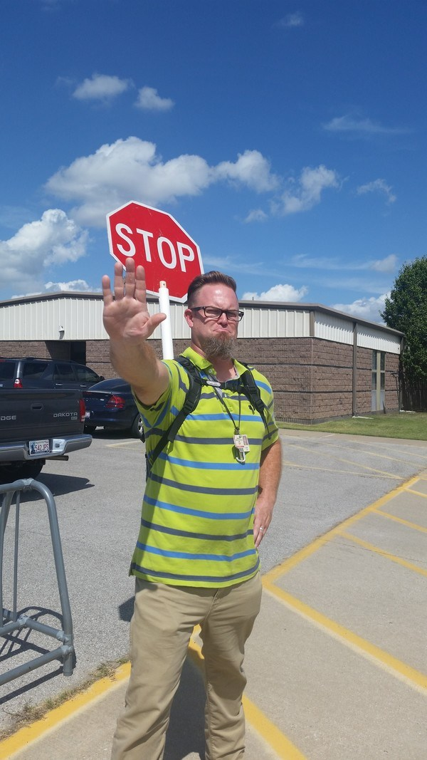 teacher with stop sign