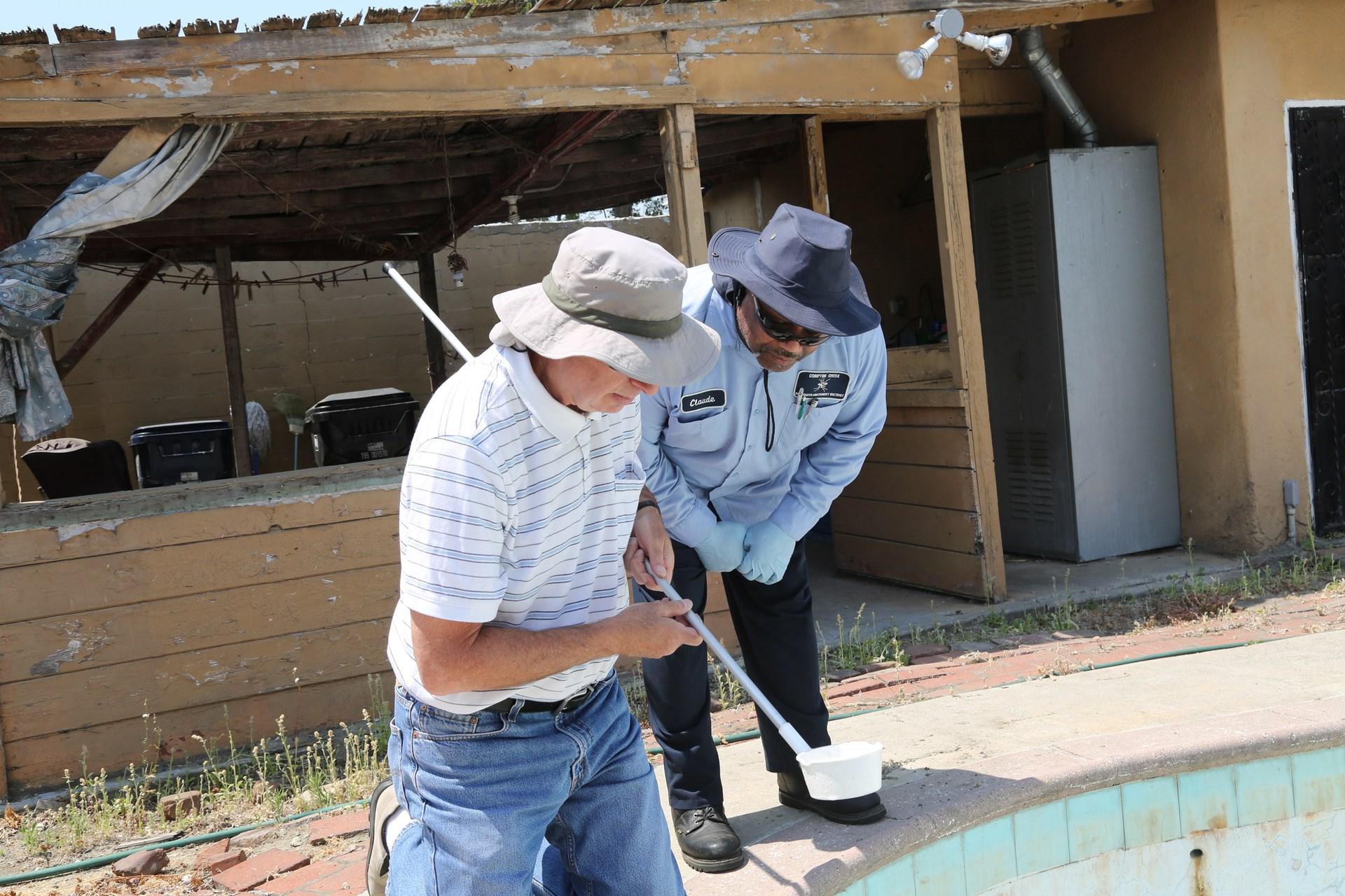 Men examine pool