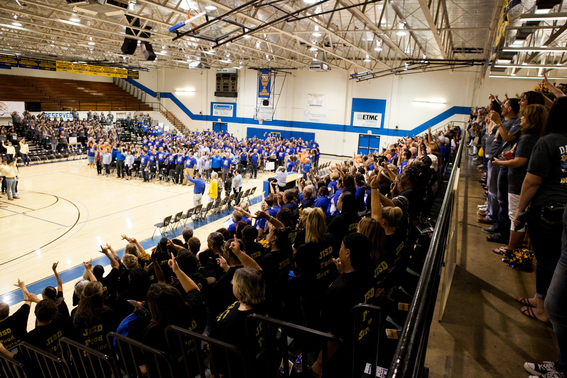 Picture of JISD principals and Superintendent f gym floor at convocation