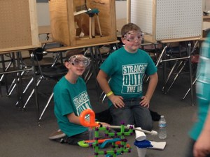 Andrew Kotyuk and Bryton Dana-Urbaniak competing in Science Olympiads.