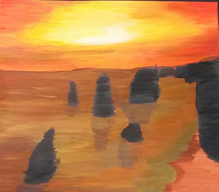Student Artwork-Painting of sunset over the ocean with rocks