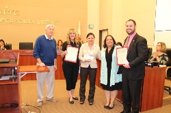 Rotary Club members receive certificates of appreciation from the Board of Education for their Teacher Mini-Grants program.