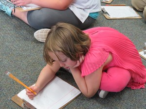A Page Elementary student revises her writing after getting tips from an author.