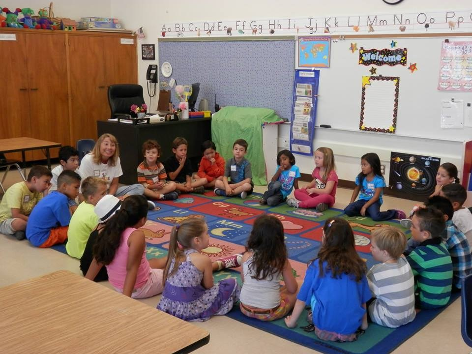 students participating in a morning meeting