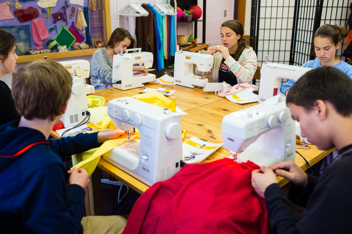 Middle school students sewing